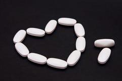 Píldoras del corazón de la medicina Fotografía de archivo