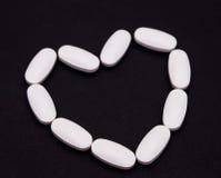 Píldoras del corazón de la medicina Imagen de archivo libre de regalías