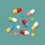 Píldoras en colores Foto de archivo libre de regalías