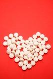 Píldoras en dimensión de una variable del corazón Foto de archivo libre de regalías