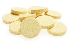 Píldoras en el fondo blanco Imagen de archivo libre de regalías