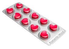 Píldoras en forma de corazón rojas del amor Foto de archivo libre de regalías