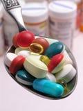 Píldoras en la cuchara 2 Fotografía de archivo libre de regalías