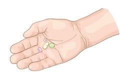 Píldoras en la mano. Imagen de archivo