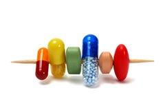 Píldoras en palillo imagen de archivo
