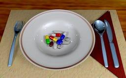 Píldoras en una placa Imágenes de archivo libres de regalías