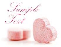 Píldoras formadas corazones del azúcar. Fotografía de archivo