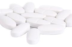 Píldoras médicas blancas Fotografía de archivo