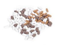 Píldoras naturales del suplemento de la vitamina Imagenes de archivo