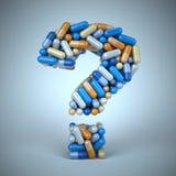 Píldoras o cápsulas como signo de interrogación en fondo azul Imagen de archivo libre de regalías