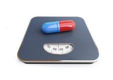 Píldoras para la escala del piso de la pérdida de peso Foto de archivo libre de regalías