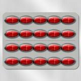 Píldoras rojas Fotografía de archivo