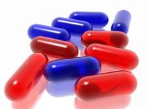 Píldoras rojas y azules ilustración del vector