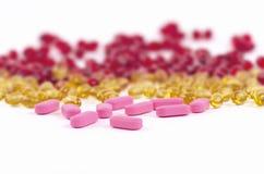 Píldoras rosadas Imágenes de archivo libres de regalías