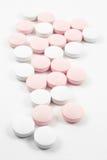 Píldoras rosadas y blancas imágenes de archivo libres de regalías