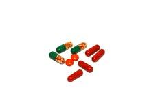 Píldoras, tabletas y cápsulas rojas Foto de archivo