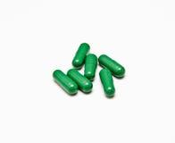 Píldoras verdes Foto de archivo libre de regalías