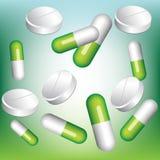 Píldoras verdes y blancas Fotos de archivo