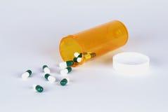 Píldoras y botella Foto de archivo libre de regalías
