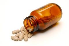 Píldoras y botella de la vitamina Imagen de archivo libre de regalías