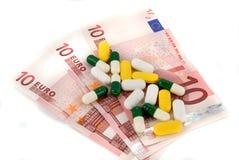 Píldoras y dinero Fotografía de archivo