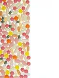 Píldoras y fondo de las cápsulas Foto de archivo libre de regalías