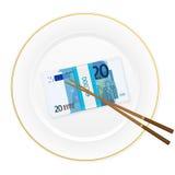 Półkowi chopsticks i dwadzieścia euro paczek Obrazy Royalty Free