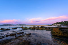 Północ kędzioru kędzioru plaża przy wschodem słońca Obraz Royalty Free
