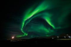 Północni światła i powstającej księżyc Nuuk niedaleki miasto Zdjęcie Stock