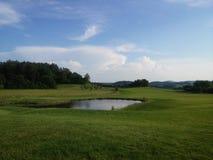 Późne popołudnie przy polem golfowym Zdjęcia Stock