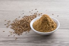 Pó e sementes do cominhos Fotografia de Stock Royalty Free