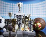 Pódio do esporte, copos da concessão dos vencedores Imagens de Stock Royalty Free