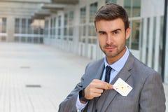 Póker que juega mostrando una tarjeta foto de archivo libre de regalías