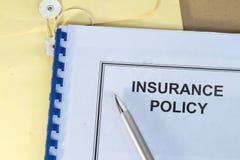Póliza de seguro Foto de archivo libre de regalías