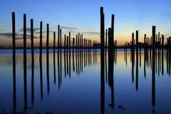 Pólos do embarcadouro no nascer do sol Fotos de Stock