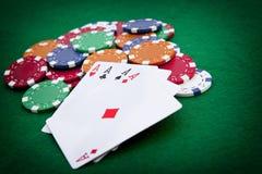 Póquer, quatro ás sobre um fundo verde Foto de Stock Royalty Free