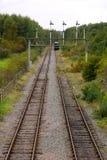 Pórtico e ferrovias de sinal Fotos de Stock Royalty Free