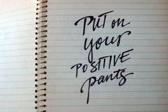 Põe sobre seu fundo caligráfico das calças positivas Imagens de Stock Royalty Free