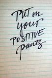 Põe sobre seu fundo caligráfico das calças positivas Imagem de Stock