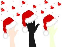 Põe suas mãos sobre o tampão de Santa Claus Imagem de Stock Royalty Free