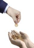 Põr seu dinheiro na mão segura Imagem de Stock