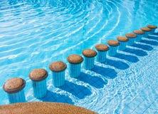 Pölplatser i simbassäng Royaltyfri Fotografi