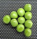 Pöltriangel av gröna ärtor Royaltyfria Bilder