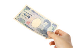 Płaci japończyka 1000YEN rachunek Obraz Royalty Free