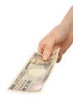 Płaci japończyka 10000YEN rachunek Obraz Royalty Free