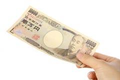 Płaci japończyka 10000YEN rachunek Zdjęcia Stock
