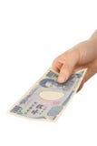 Płaci japończyka 1000YEN rachunek Obraz Stock