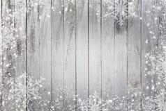 Płatki śniegu jako granica na drewnianym tle obraz royalty free