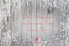 Płatki śniegu na drewnianym tle z tekstów Wesoło bożymi narodzeniami i Szczęśliwym nowym rokiem ilustracja wektor