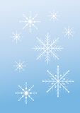 Płatki śniegu na mlecznoniebieskim tle Fotografia Stock